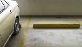Indoor parking car. Empty parking car with yellow line deviding car Stock Photos