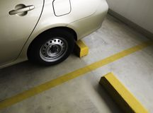 Indoor parking car. Empty parking car with yellow line deviding car Stock Photo