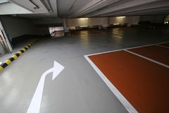 Empty parking garage with arrow for left or straight ahead Royalty Free Stock Images
