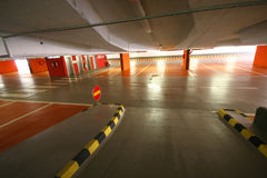 Empty parking garage with arrow for left or straight ahead Stock Image