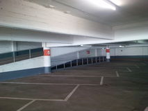 Empty parking garage. Creepy empty old concrete parking garage Royalty Free Stock Images
