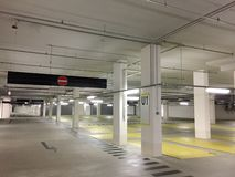Empty parking garage in Germany. Empty slots, concrete walls and pillars royalty free stock photos