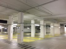 Empty parking garage in Germany. Empty slots, concrete walls and pillars stock image
