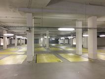 Empty parking garage in Germany. Empty slots, concrete walls and pillars stock photo