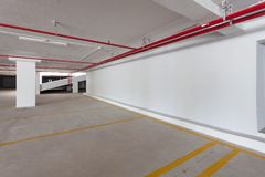 Empty parking garage underground interior in apartment or busine Royalty Free Stock Photo