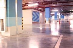 Empty parking garage underground interior in apartment or in sup. Ermarket stock photos