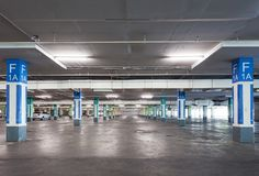 Empty parking garage underground interior in apartment or in sup. Ermarket royalty free stock photography