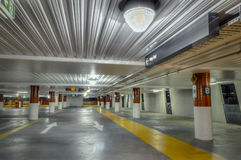 Empty Parking Interior. With red and white columns and yellow walkway in hdr Royalty Free Stock Image