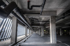 Empty Parking Interior (day). Grey concrete and asphalt parking interior Royalty Free Stock Photo