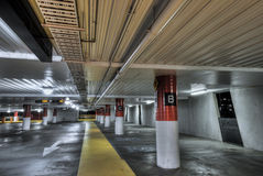 Empty Parking Interior at Night. Parking interior with red and white columns Royalty Free Stock Image