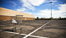 Empty Parking Lot. Out of business grocery store parking lot royalty free stock photo