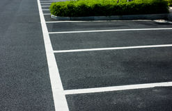 Empty parking lot. Empty parking spaces await commuters Royalty Free Stock Photography
