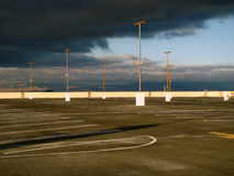Empty Parking Lot. An empty parking lot with storm clouds Stock Image