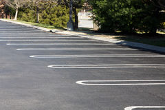 Empty parking lot. Abandoned parking lot with plenty of available parking Stock Image