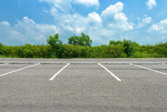 Empty parking lot. On blue sky background Royalty Free Stock Photography