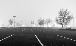 Empty parking lot at night. With heavy fog royalty free stock photo