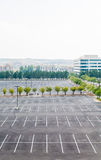 Empty Parking Lot with One Car. Empty parking lot with one white car in distance Royalty Free Stock Image