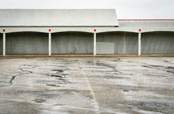 Empty parking lot of a shut down mall Stock Photo