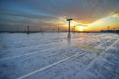 Sunset over parking lot. Empty parking lot and the sunset above it. Israel Royalty Free Stock Photography