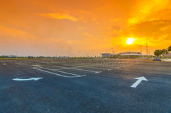 Empty parking lot. With sunset background Stock Photos