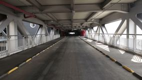 Empty parking lot tunnel road. Industrial interior stock video footage