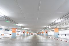 Empty parking lot in Underground parking. Royalty Free Stock Photography