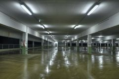 Empty Parking Lot. An empty underground parking lot at night stock image