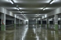 Empty Parking Lot. An empty underground parking lot at night Stock Images