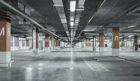Empty parking lot. Urban, industrial background. Empty parking lot wall Urban, industrial background stock images