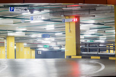 Empty parking lot. Parking lot with yellow pillars and many lights Royalty Free Stock Photo