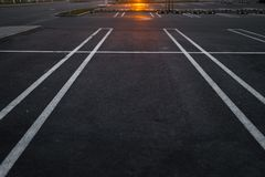 Empty parking lots during Golden Hour sunset at a popular typical Shopping centre royalty free stock image