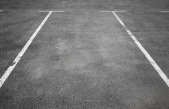 Empty parking place with white marking lines Stock Photos