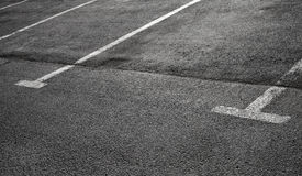 Empty parking places on dark asphalt Royalty Free Stock Photography