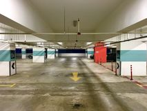 Empty parking space in a building with emergency button on the red column on the right Royalty Free Stock Photography