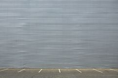 Empty parking spaces on the background of a metal wall with space for product placement. Empty parking spaces on the background of a metal wall with plenty of stock images