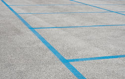 Empty parking Spaces with blue Stripes Stock Photo