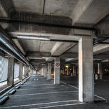 Empty Parkng Interior. Diminishing perspective shot of parking lot interior with large waste disposal tube in foreground Royalty Free Stock Photography