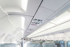 An empty passenger airliner. Commercial aircraft cabin with rows. Of grey seats down the aisle. Vacation destinations concept Royalty Free Stock Photography