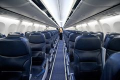 Empty passenger airplane seats in the cabin of plane.  stock photos