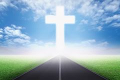 Empty path on the field going to Christian cross.  Stock Photography