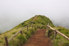 Empty path to a viewpoint over Sete Cidades lagoon on Azores on cloudy weather Royalty Free Stock Images