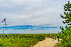 Empty pathway with fence to the beach on a clear summer day in Provincetown, Cape Cod, Massachusetts. USA Stock Photography