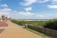 Empty Paved Promenade Against Coastal City Skyline Stock Images