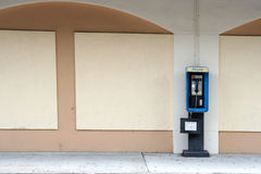 Empty Pay phone. Pay phone on side of building Stock Photo