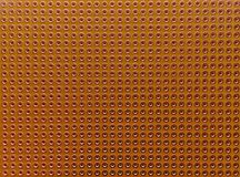 Empty pcb board. With copper coated holes for diy electronic projects. Close up seamless background stock images