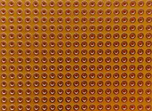 Empty pcb board. With copper coated holes for diy electronic projects. Close up seamless background royalty free stock photo