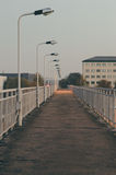 Empty pedestrian bridge at dusk Royalty Free Stock Images