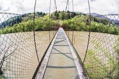 Empty pedestrian bridge. Long empty pedestrian bridge over river Orava, Slovakia. Summer 2017 royalty free stock image