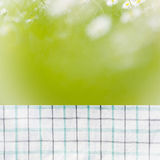 Empty perspective kitchen towel over blurred trees with bokeh background, for product display montage Stock Image