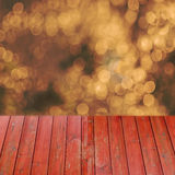 Empty perspective red wood over blurred trees with bokeh background, for product display montage Stock Image